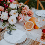 The centerpieces for this colorful late summer wedding with boho accents has vintage and modern elements, juicy centerpieces, hand calligraphed seating cards and textured glassware and chargers.