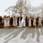 Bride and groom and their wedding party pose in groupings at this late summer wedding ceremony at Torrey Pines Reserve.
