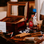 A cigar rolling station pays homage to the bride's family's Cuban roots at this wedding at Inn at Rancho Santa Fe.