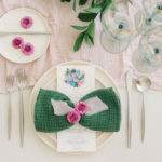A textured napkin is tied like a bow and dresses up a simple tablescape.