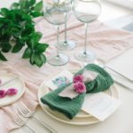 This playful napkin folded like a bow dresses up this simple tablescape.