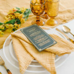 A textured napkin is folded in the French style and dresses up a simple tablescape.