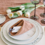 The fortune cookie napkin fold creates a perfect slit to hold a place card.