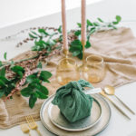 This Furoshiki style is just one of our stylish napkin ideas that will elevate your table.