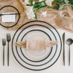 A textured napkin is folded like a candy roll and adds playfulness to this modern tablescape.