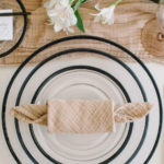 The candy roll is just one of our stylish napkin folding ideas to enhance your dining table.