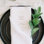 This simple white linen with high contrast black stitch border is the perfect linen for this Angled Single Pocket Fold.