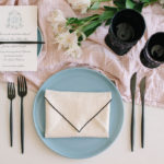 This Envelope fold is a stylish napkin folding idea works with a classic or modern table setting.