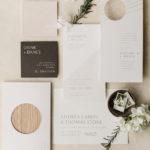 A modern stationery suite includes graphic shapes and cutouts.