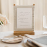 A John Steinbeck quote accompanies a wedding dining table.