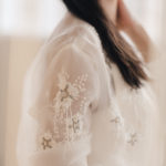 Louvienne's bridal bomber jacket with delicate embroidery adds edge to this bridal look.