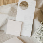 Geometric patterns and cutouts create interest in this stationery suite.