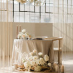 A romantic table for two is set in between the light and shadows of the industrial space.