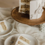 A vegan mini wedding cake is sliced for the brides to enjoy at their elopement.