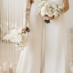 Two brides with distinctive fashion styles pose with their romantic bouquets.